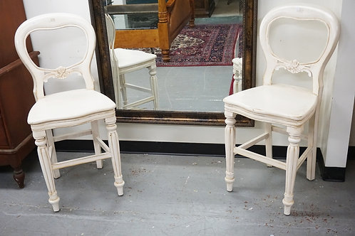 PAIR OF CARVED STOOLS IN WHITE PAINT. 43 1/2 INCHES HIGH.