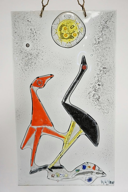 OUTSTANDING FUSED GLASS PANEL DEPICTING TWO BIRDS AND THE SUN. SIGNED LOWER RIGH