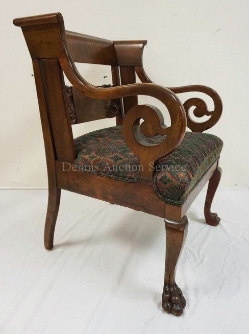 CARVED MAHOGANY ARMCHAIR WITH A CARVED BACK, BALL & CLAW FEET, AND SCROLLED ARMS