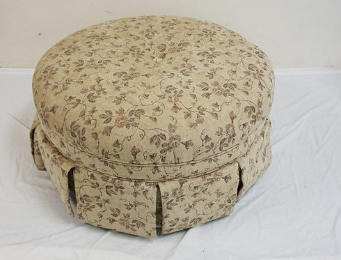 ROUND FLORAL UPHOLTERED OTTOMAN. 39 INCH DIA. 20 INCHES HIGH.