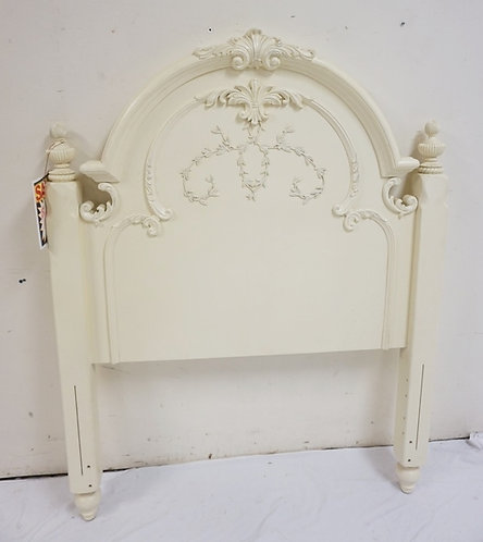 NEW FURNITURE LIQUIDATION. CARVED TWIN SIZE HEADB OARD, PAINTED WHITE. 42 IN WID