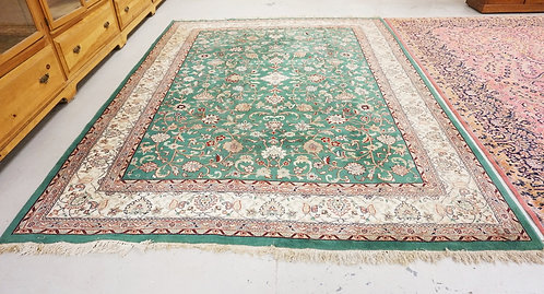 ROOM SIZE ORIENTAL RUG MEASURING 8 FT 10 INCHES X 11 FT 10 INCHES.