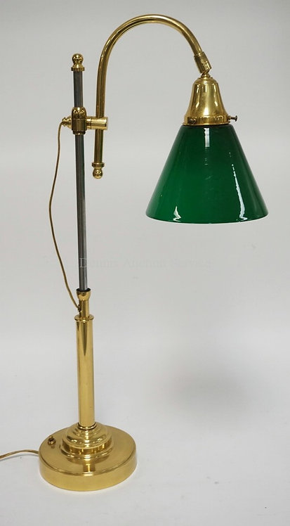 BRASS LAMP WITH AN ADJUSTABLE TELESCOPING STEM AND A CASED EMERALD GREEN SHADE (