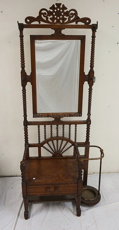 VICTORIAN OAK HALL RACK WITH SPOOL TURNED SPINDLES, A CARVED CREST, AND A BEVELE
