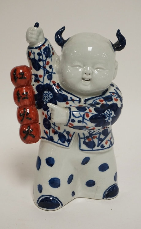 ASIAN PORCELAIN FIGURE. CHARACTER SIGNED. 7 3/4 INCHES HIGH.