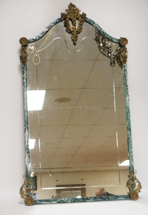 DECORATIVE WALL MIRROR WITH A MARBLE FINISHED FRAME AND BRASS MOUNTS. 23 1/2 X 4