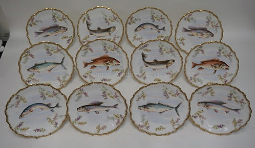 SET OF 12 FRENCH LIMOGES FISH PLATES. 9 1/2 INCH DIA. 3 WITH CHIPS, ONE WITH A S