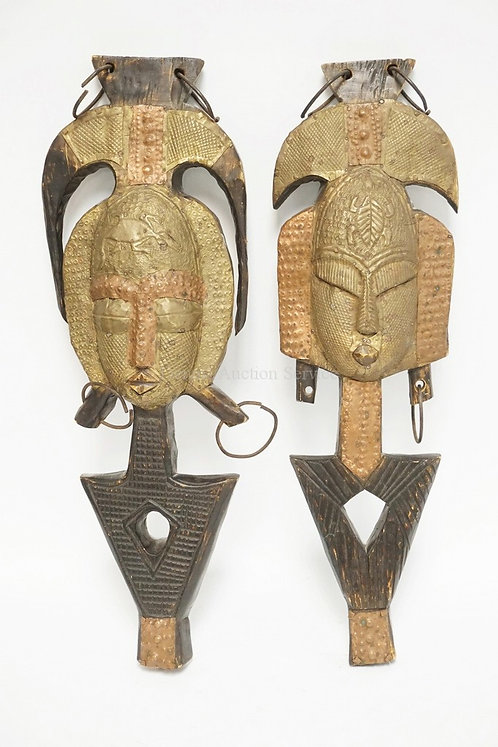 PAIR OF CARVED ETHNIC WALL HANGING DECORATIONS. 25 1/2 INCHES LONG.
