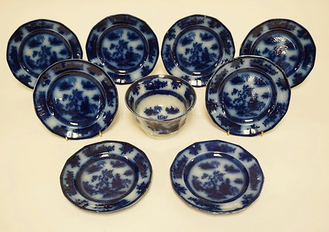 9 PIECE FLOW BLUE WEDGWOOD *CHAPOO*. EIGHT 6 3/8 INCH PLATES AND A WASTE BOWL. O
