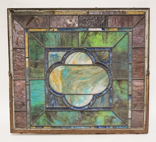 LEADED GLASS WINDOW MEASURING 28 1/2 X 25 1/2 INCHES. ONE DAMAGED PANEL.