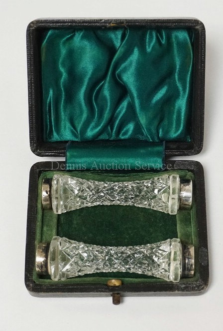 PAIR OF CUT CRYSTAL KNIFE RESTS WITH STERLING SILVER BANDS ON EACH END. COMES IN