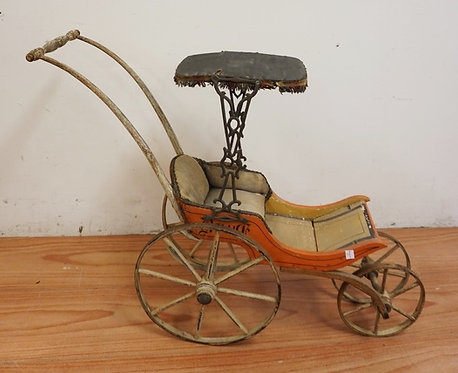 ANTIQUE VICTORIAN DOLL CARRIAGE MEASURING 24 3/4 INCHES HIGH.