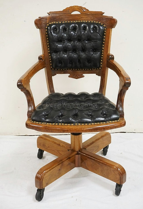 VICTORIAN OFFICE CHAIR WITH A TUFTED LEATHER SEAT AND BACK. BASE IS CUSTOM MADE.