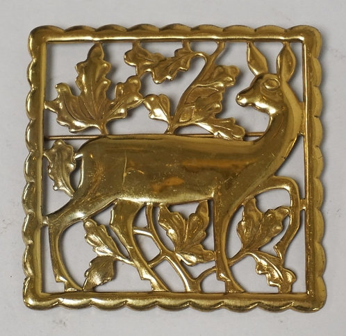 STERLING SILVER OPENWORK BROOCH DEPICTING A DEER & FOLIATE. 2 3/8 INCHES SQUARE.