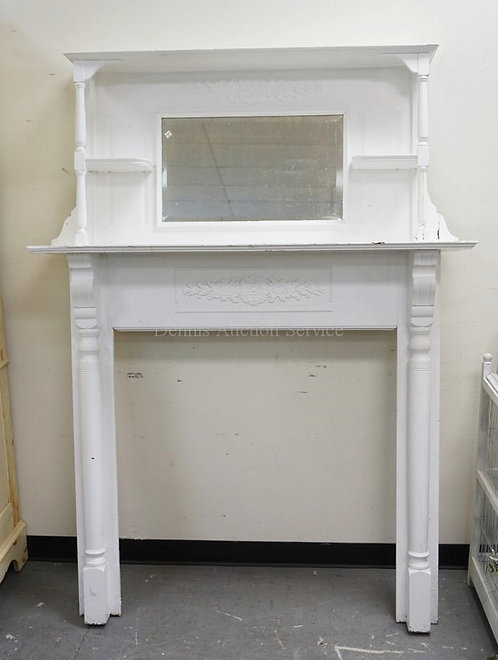 MANTEL WITH APPLIED CARVINGS, FULL COLUMN SIDES, AND A HIGH MIRRORED AND SHELVED