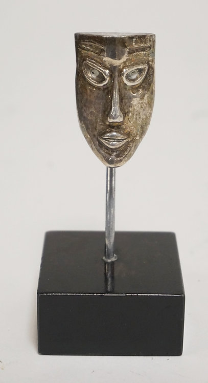 STERLING SILVER SCULPTURE OF A MASK. ARTIST INITIALED *JB*. 4 1/8 INCHES HIGH.