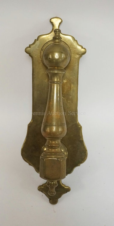 LARGE ANTIQUE BRASS DOOR KNOCKER MEASURING 11 1/2 INCHES LONG.