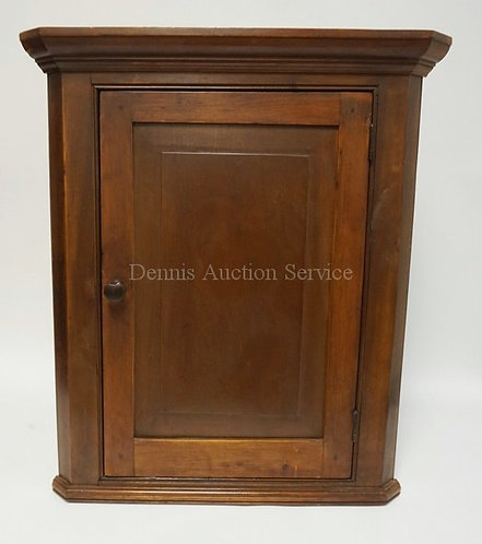HANGING COUNTRY CORNER CABINET WITH A PANELED DOOR. 29 1/2 INCHES HIGH. 25 1/2 I