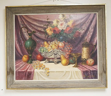 STILL LIFE OIL PAINTING ON CANVAS OF FRUIT, FLOWERS, A EWER, AND A STEIN ON A TA