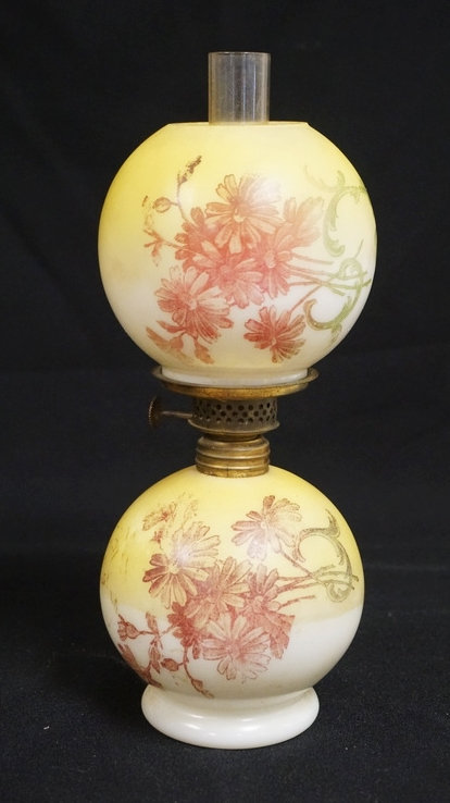 MINIATURE OIL LAMP IN YELLOW & WHITE AND TRANSFER DECORATED WITH FLOWERS. 9 1/2