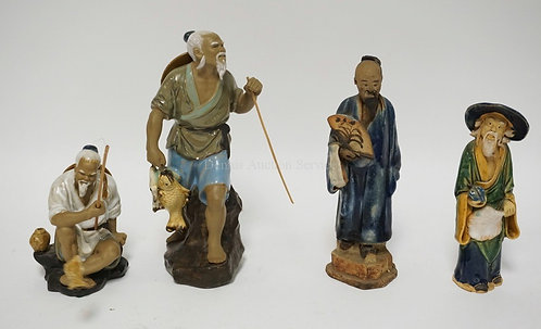 LOT OF 4 ASIAN MUD MEN FIGURES. TALLEST IS 9 INCHES. BASE REPAIR ON ONE FIGURE.