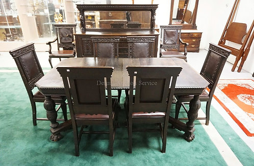 ANTIQUE CARVED OAK DINING ROOM SET WITH PAW FEET, CARVED DOOR PANELS, AND GRIFFI