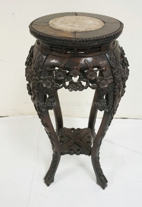 HEAVILY CARVED ASIAN STAND WITH INSET BROWN MARBLE TOP. 27 1/2 IN H, 11 1/2 IN T