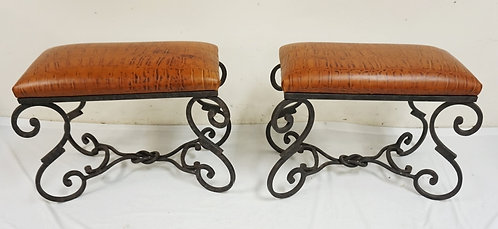 PAIR OF FAUX ALLIGATOR STOOLS WITH FANCY IRON BASES. TOPS ARE 24 IN X 12 IN, 20