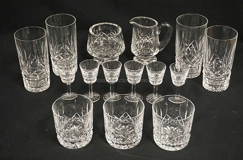 15 PIECES OF WATERFORD *LISMORE* CUT CRYSTAL. INCLUDES A PEDESTAL CREAM & SUGAR,