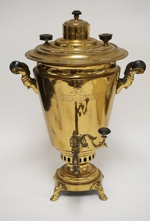RUSSIAN BRASS SAMOVAR. 19 INCHES HIGH. ONE WOODEN HANDLE IS MOISSING A BOLT.