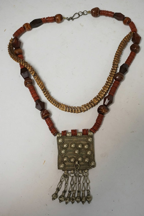 NECKLACE WITH ANCIENT ROMAN BEADS, AGATE, SNAKE VERTIBRAE, AND AN AFGHAN NOMAD P