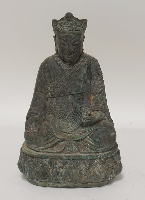 ASIAN BRONZE SEATED MAN. 8 1/2 INCHES HIGH.