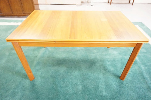 DANISH MODERN DINING TABLE WITH EXTENDING LEAVES. LABEL OF *BRDR. FURBO*. 35 1/2