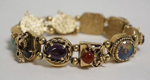 14K GOLD BRACELET WITH VARYING STONES AND FIGURED LINKS (DRAGON, SNAKE, ETC.) 23