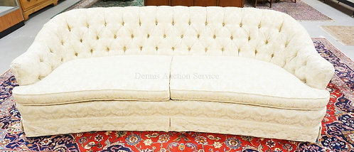 UPHOLSTERED SOFA WITH A TUFTED BACK. MADE IN NORTH CAROLINE. 91 INCHES LONG.