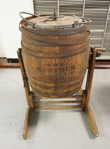 ANTIQUE BARREL FORM BUTTER CHURN WITH STAND.