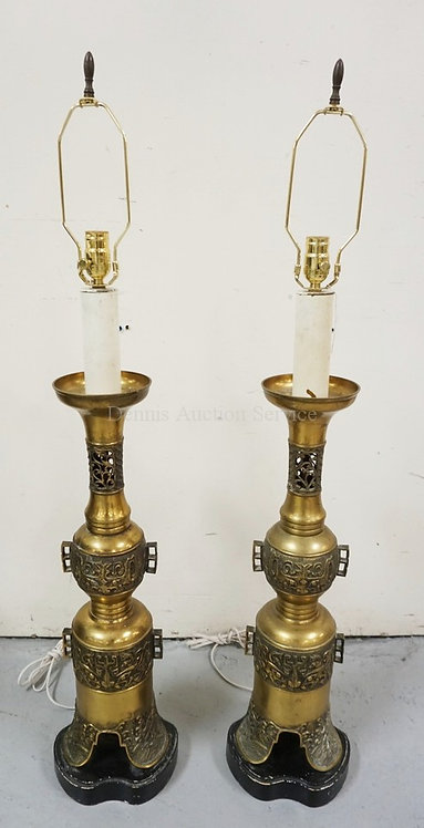 PAIR OF TALL ASIAN BRASS LAMPS. MOUNTED ON WOODEN BASES. 46 1/2 IN H