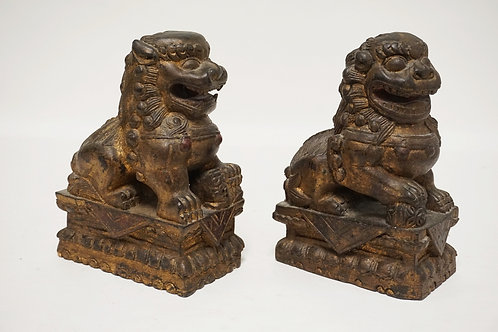 PAIR OF CARVED AND GOLD GILT WOODEN FOO DOGS. 9 3/4 INCHES HIGH.