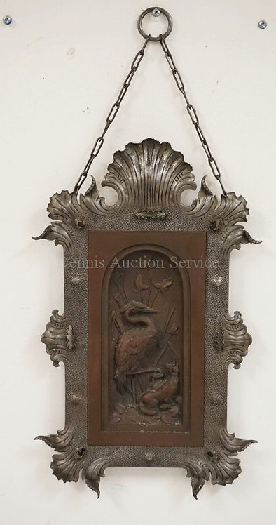 IRON & COPPER WALL HANGING. A RELIEF DECORATED COPPER PANEL DEPICTING A CRANE AN