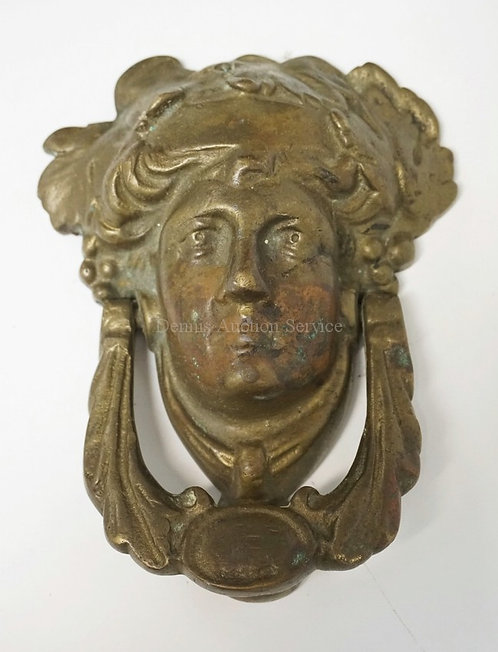 FIGURAL BRONZE DOOR KNOCKER IN THE FORM OF A FACE. 6 1/2 X 5 INCHES.
