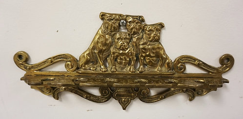 FIGURAL BRASS PIPE RACK WITH BULLDOGS AS A CREST. 12 1/4 INCHES LONG.