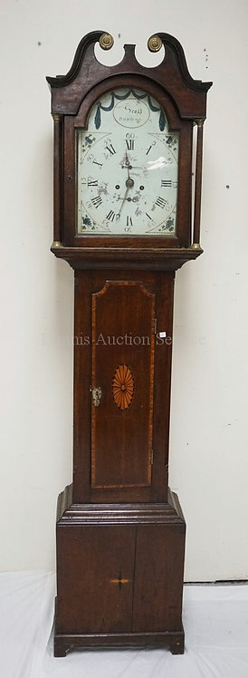 OAK TALL CASE CLOCK WITH A PAINTED WOODEN FACE AND BRASS WORKS. CASE DECORATED W