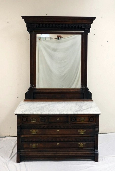 CARVED AND BURLED VICTORIAN CHEST OF DRAWERS WITH A MARBLE TOP AND A HIGH MIRROR