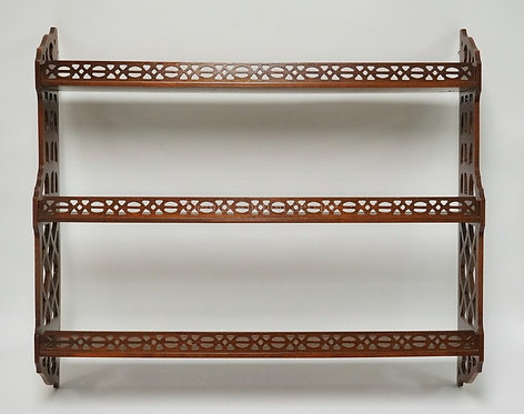 MAHOGANY 3 TIER HANGING SHELF WITH CUTWORK SIDES AND SHELF FRONTS. 34 1/4 INCHES