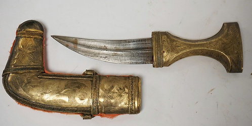 MIDDLE EASTERN KNIFE WITH A HAND TOOLED METAL SHEATH (POSSIBLY A LOW GRADE SILVE