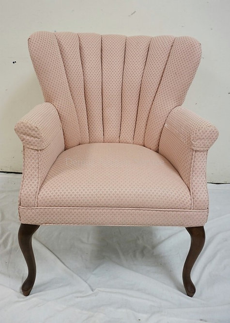 UPHOLSTERED ARMCHAIR WITH A FLUTED BACK. 35 INCHES HIGH. 27 1/2 INCHES WIDE.