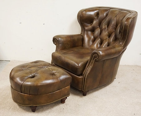 BRADINGTON YOUNG LEATHER CHAIR AND OTTOMAN. MISSING ONE BUTTON MISSING IN THE TU