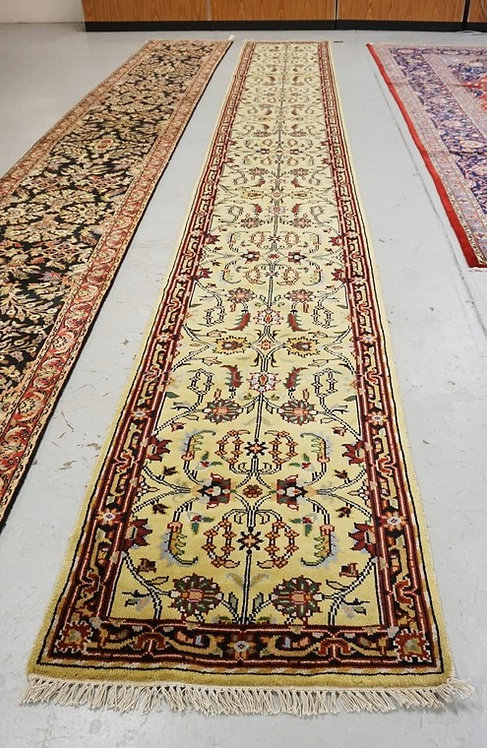 HAND KNOTTED ORIENTAL RUNNER MEASURING 20 FT X 2 FT 6 INCHES.
