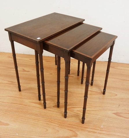 1024_NEST OF 3 BANDED MAHOGANY TABLES WITH BAMBOO TURNED LEGS. LARGEST IS 24 INC