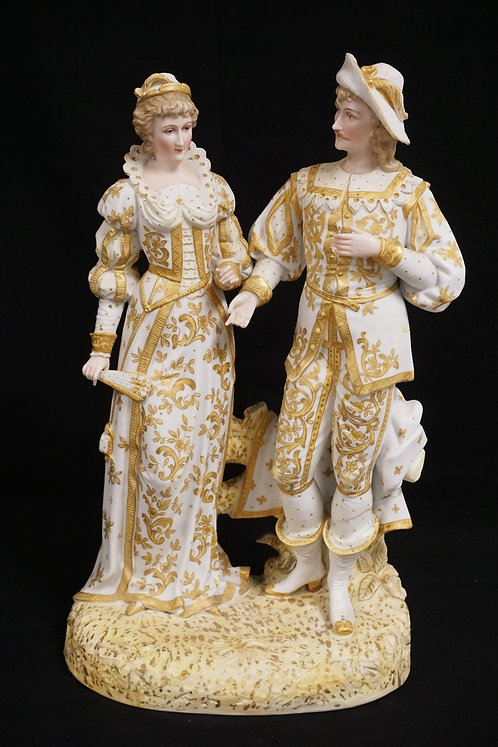 HAND PAINTED PORCELAIN FIGURAL GROUP. HAS REPAIRS.